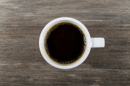 cofee cup: cup of black coffee on wooden table Stock Photo