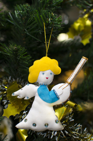 christmas decoration handmade toy Angel hanging over rustic wooden background photo