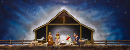 A nativity scene, creche, or crib, is a depiction of the birth of Jesus Stock Photo