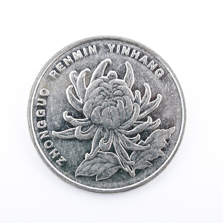 Chinese Yuan closeup on white background