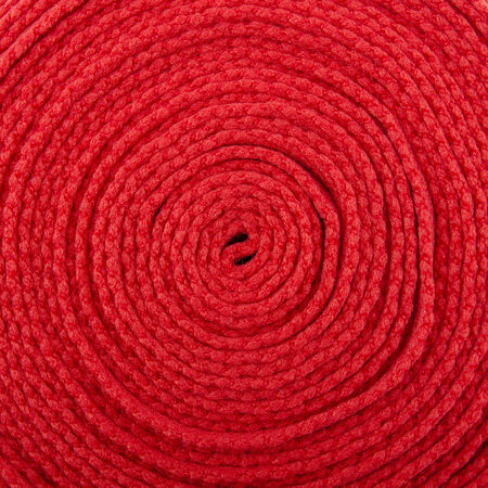 needlecraft product: Macro view of red thread wound on a spool Stock Photo