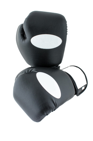 Photo of a pair of black and white boxing gloves