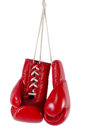 hand gloves: Red boxing gloves hanging isolated on white Stock Photo