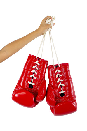 Hand holds a boxing glove Stock Photo