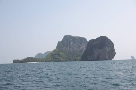 Tropical island in the ocean with blue sky background, krabi , Thailand  photo