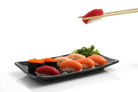 Sushi isolated on black dish photo