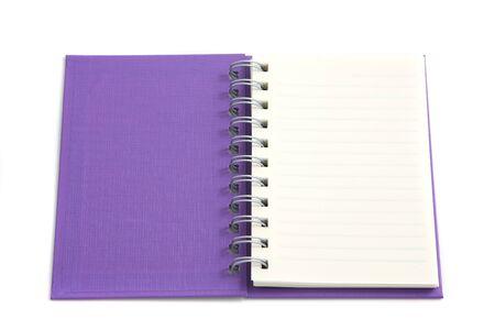 purple notebook isolated on white background  photo