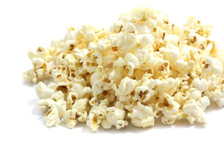 A pile of salted popcorn isolated on white background.