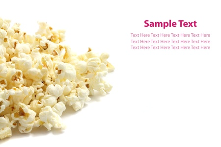 A pile of salted popcorn isolated on white background. Stock Photo - 10039996