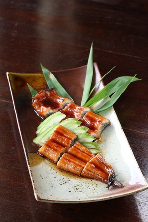 japanese food roast eel ( unagi ) with dark brown wood pattern  photo