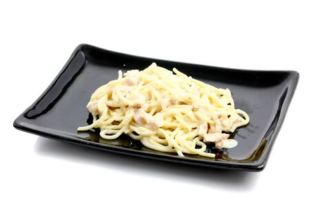 spaghetti carbonara isolated in white background photo