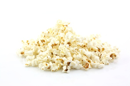 scattered on white background: popcorn isolated in white background Stock Photo