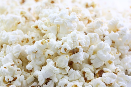 macro film: popcorn isolated in white background Stock Photo