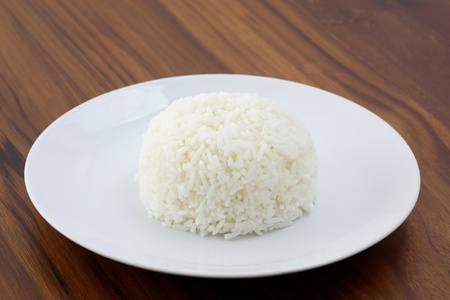 bowl with rice: Rice in wood background