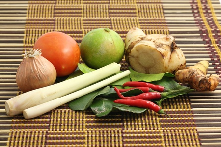 tom yum ingredient isolated in wood background photo