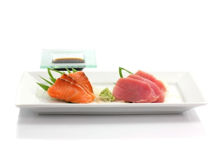 salmon and tuna sashimi on dish isolated in white background
