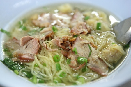 Chinese food noodle with grilled pork photo