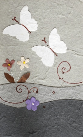 papercraft: papercraft butterfly with flower in grey background Stock Photo