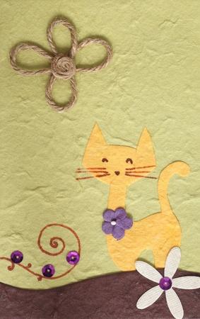 scrapbook homemade: Papercraft Cat and flower green background  Stock Photo