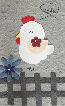 papercraft Chicken with flower grey background  photo