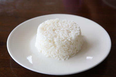 Rice in wood background photo