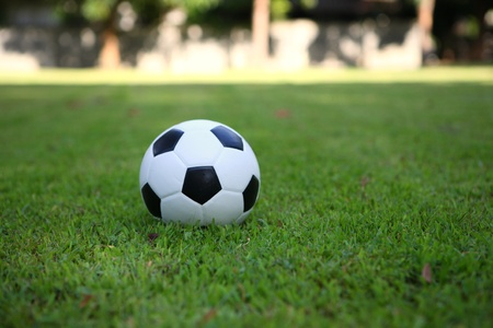 football on grass background photo