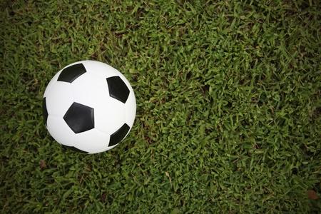football on grass background photo