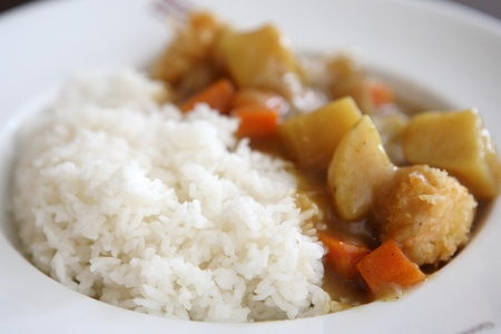 Rice with curry on dish photo