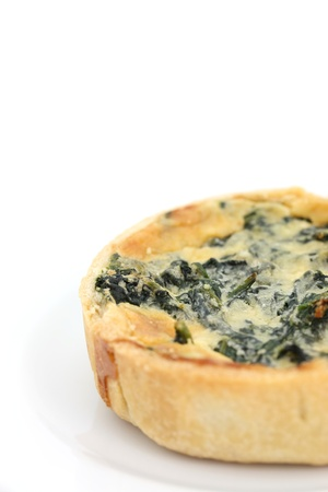 spinach quiche pie isolated on white background photo