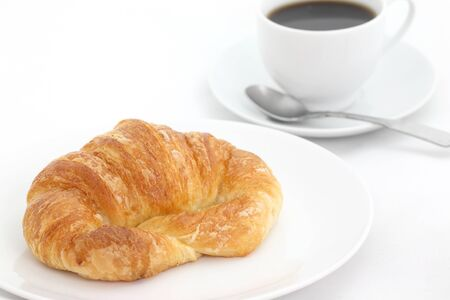 croissant with coffee isolated in white background photo