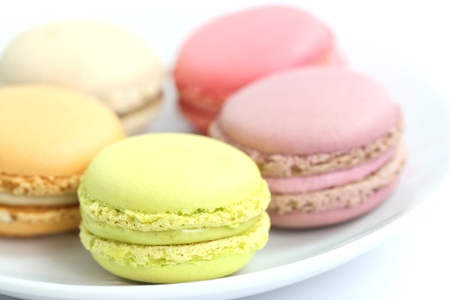 Colorful Macaron in close up isolated on white background photo