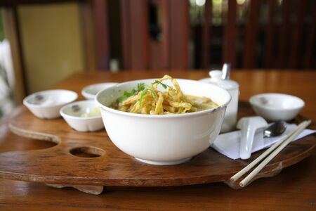 Noodle Khao soi , Thai food on wood background photo