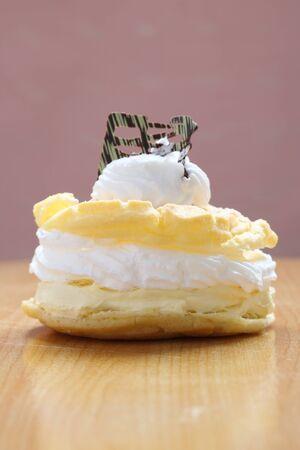 Cream puff cake Dessert on wood background photo
