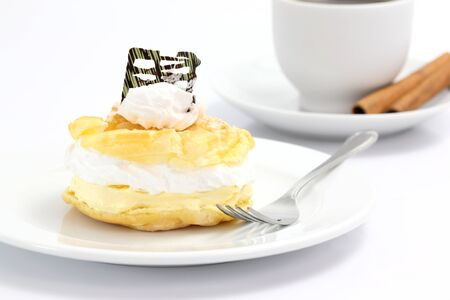 creampuff: Cream puff cake Dessert and coffee isolated in white background Stock Photo