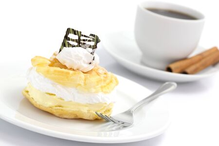 Cream puff cake Dessert and coffee isolated in white background photo