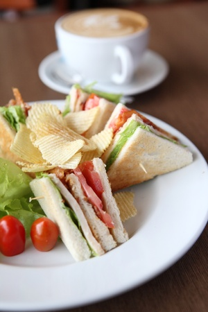 Club sandwich with coffee on wood background Stock Photo - 10941945