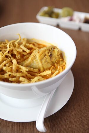 soi: Noodle Khao soi , Thai food on wood background