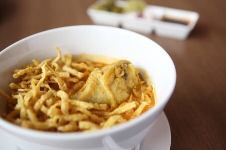 soi: Noodle Khao soi , Thai food on wood background