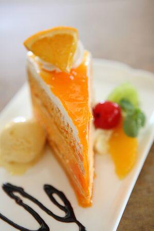 Orange cake on wood background photo