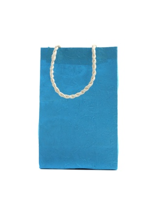 Blue paper bag isolated in white background photo
