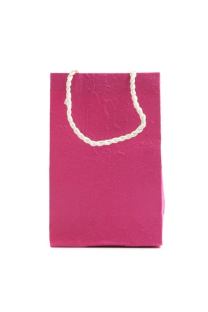 Pink paper bag isolated in white background photo