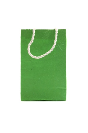 Green paper bag isolated in white background photo