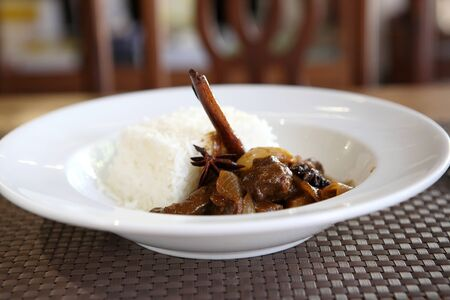 Beef curry with rice , Thai food on wood background photo
