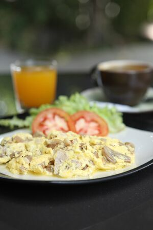 Omelette with mushroom and bacon , orange juice and coffee for background photo