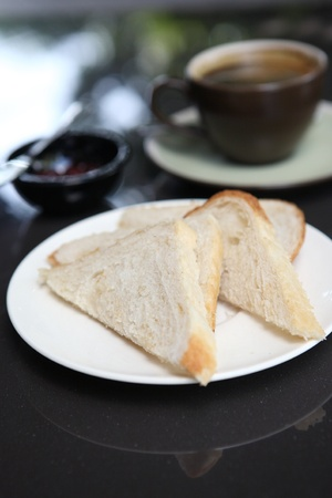 slice of bread with coffee photo