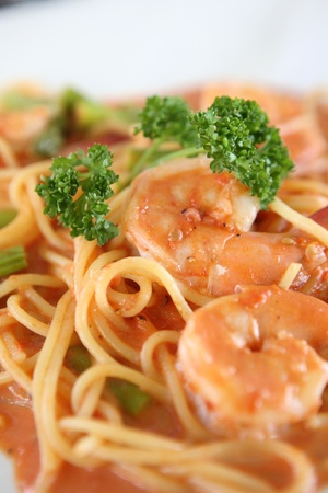 linguine pasta with shrimps in tomato sauce   photo