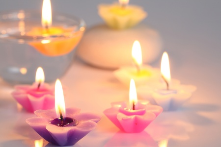 aroma bowl: flower candles isolated in white background Stock Photo