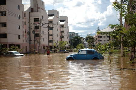 CHIANGMAI , THAILAND - SEPTEMBER 29 : Cars in water flooded streets on September 30, 2011 in Nonghoi , Muang , Chiangmai , Thailand.