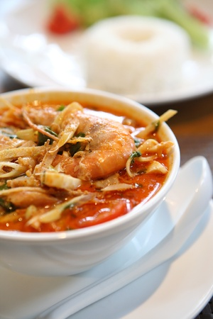 yum: Tom Yum soup , a Thai traditional spicy prawn soup with rice