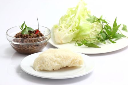 Thai food minced meat with vegetable and chilli isolated in white background photo